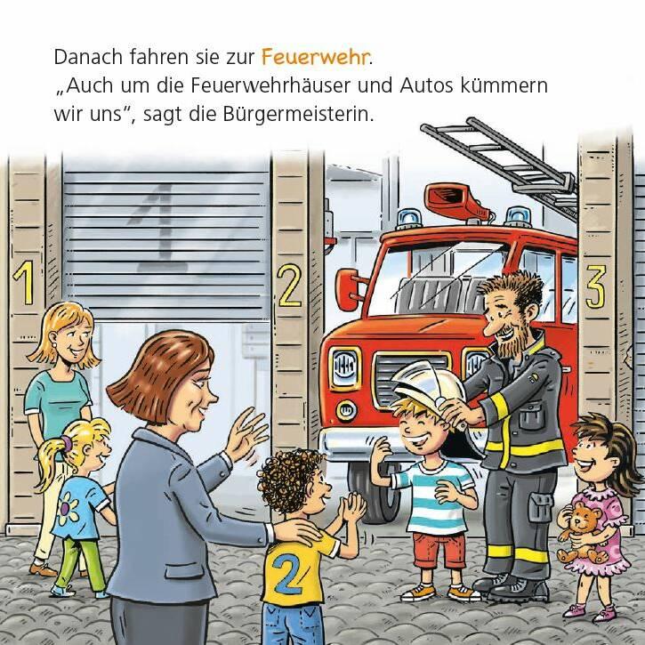 Kinder und Bürgermeisterin bei der Feuerwehr.